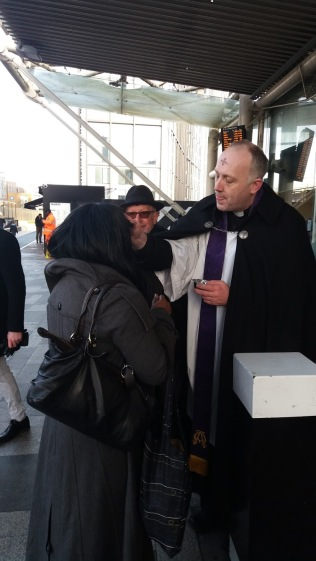 Fr Robert imposes ashes.